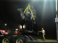 """Workers removed the Robert E. Lee and Thomas J. """"Stonewall"""" Jackson monument in Baltimore during the night. Credit Jerry Jackson/The Baltimore Sun, via Associated Press"""