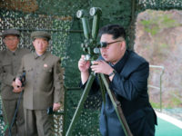 DEMOCRATIC PEOPLE'S REPUBLIC OF KOREA : This picture released from North Korea's official Korean Central News Agency (KCNA) on April 24, 2016 shows North Korean leader Kim Jong-Un (R) inspecting an underwater test-fire of a strategic submarine ballistic missile at an undisclosed location in North Korea on April 23, 2016. North Korean leader Kim Jong-Un hailed a submarine-launched ballistic missile (SLBM) test as an