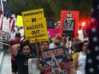 Immigrants and supporters chant during a