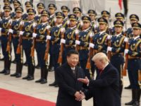 "In this Nov. 9, 2017, file photo, President Donald Trump and Chinese President Xi Jinping participate in a welcome ceremony at the Great Hall of the People in Beijing, China. Trump couldn't seem to stop talking about the red carpets, military parades and fancy dinners that were lavished upon him during ""state visits"" on his recent tour of Asia. ""Magnificent,"" he declared at one point on the trip. But Trump has yet to reciprocate in kind. In fact, he is the first president in decades to close his first year in office without welcoming a counterpart on a visit to the U.S. with similar trappings. (AP Photo/Andrew Harnik, File)"