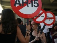 FORT LAUDERDALE, FL - FEBRUARY 17: Mercedes Kent joins other people after a school shooting that killed 17 to protest against guns on the steps of the Broward County Federal courthouse on February 17, 2018 in Fort Lauderdale, Florida. Earlier this week former student Nikolas Cruz opened fire with a AR-15 rifle at the Marjory Stoneman Douglas High School killing 17 people. (Photo by Joe Raedle/Getty Images)